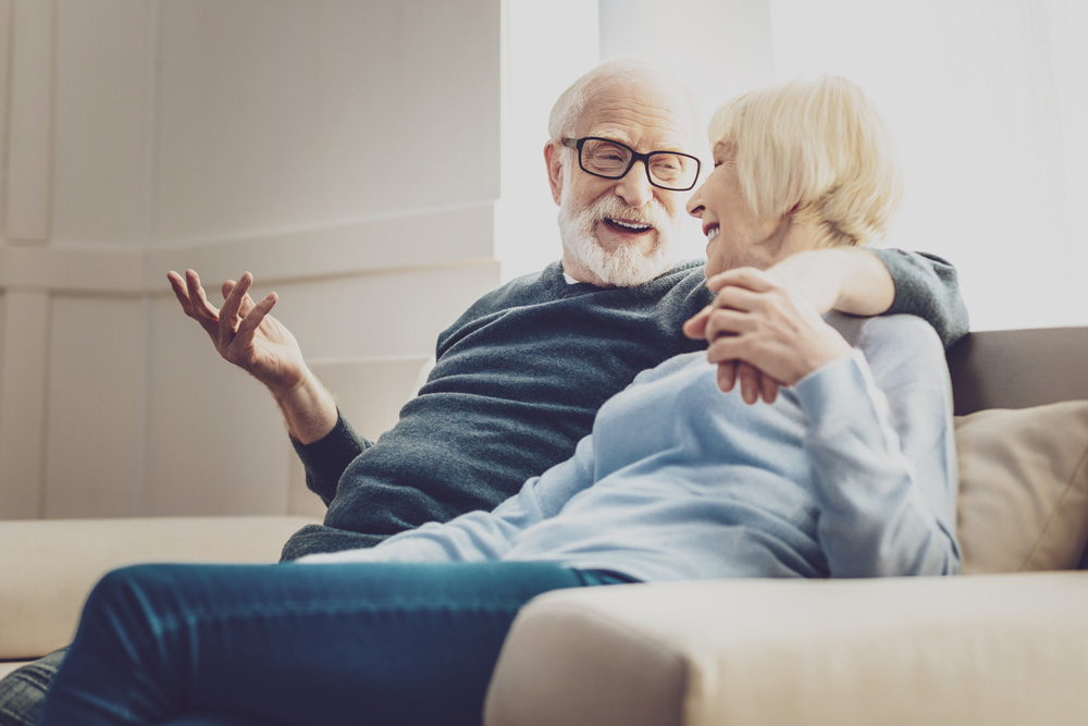 elderly couple discussing estate planning.