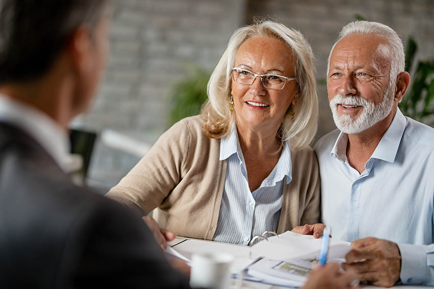 Happy older couple talking about their estate plan and feeling very positive and optimistic